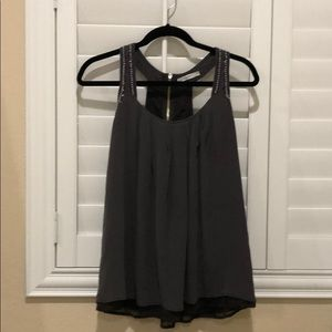 Charcoal gray embellished detail flowy top.